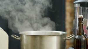 depositphotos_200634868-stock-video-saucepan-with-steam-the-smoke