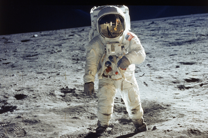 Apollo 11 astronaut Buzz Aldrin standing on moon,