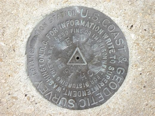 Bronze disc geodetic marker Meades Ranch